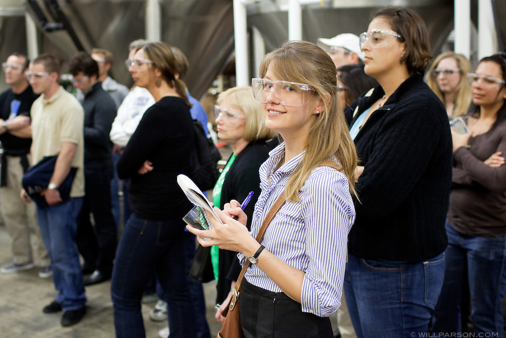 Journalist Claire Trageser takes notes during a brewery tour at the facilities of Ballast Point Brewing Company in San Diego.