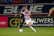 26-01-2016 VOETBAL:WILLEM II-FC GRONINGEN:TILBURG<br /> <br /> Johan Kappelhof van FC Groningen in duel met  Frank van der Struijk van Willem II <br /> <br /> Foto: Geert van Erven