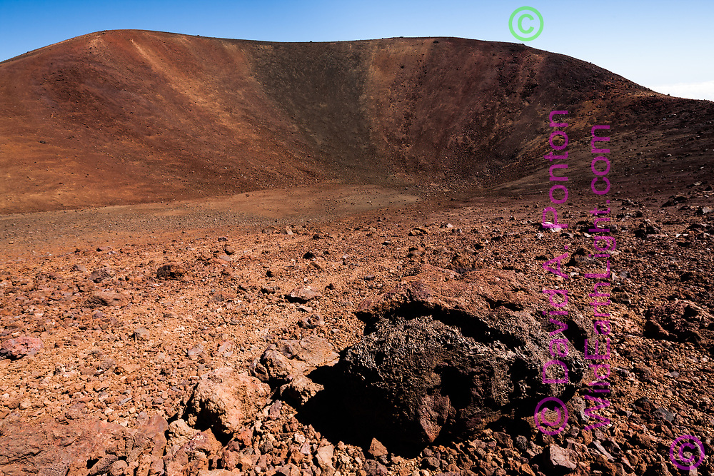 Igneous rock along the inner  slope of a small volcanic crater at the summit of Mauna Kea. Summit is at the upper left. Big Island, Hawaii, © 2010 David A. Ponton