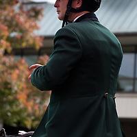 Keeneland Outrider awaits thoroughbreds in the paddock during the 2009 Fall Meet.