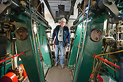 ****COPY HERE****  (https://www.dropbox.com/s/5mg81qiiuy22tre/adamson.rtf?dl=0)   © Licensed to London News Pictures. 02/12/2014. Liverpool , UK .  Volunteer Kev Lytton in the partially restored engine rom.  The only surviving steam powered tug tender, the Daniel Adamson, is being completely renovated by a team of volunteers in Liverpool. The vessel, which has had 90,000 man hours already spent on it, was bought for only one pound is the awaiting the decision of the Heritage Lottery Fund on an application of £3.6m to bring her back to her full glory.  . Photo credit : Stephen Simpson/LNP<br /> <br /> COPY HERE https://www.dropbox.com/s/5mg81qiiuy22tre/adamson.rtf?dl=0