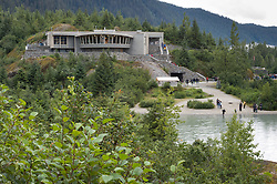 The Mendenhall Glacier Visitor Center in the Tongass National Forest, located 12 miles from downtown Juneau, Alaska was the first such visitor center built by the U.S. National Forest Service. The visitor center was later expanded and now sees over 500,000 visitors a year. From the visitor center visitors can view the icebergs that calve into Mendenhall Lake.