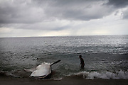 a dead whale shark in lamalera beach. Residents in the lamalera village, Indonesia cathing  sperm whales with traditional method to provide meals for the entire village and part of the Lembata island where the village is located..