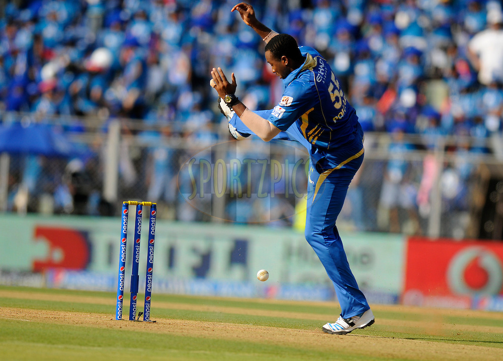 Kieron Pollard of the Mumbai Indians collects a ball during match 22 of the Pepsi Indian Premier League Season 2014 between the Mumbai Indians and the Kings XI Punjab held at the Wankhede Cricket Stadium, Mumbai, India on the 3rd May  2014<br /> <br /> Photo by Pal Pillai / IPL / SPORTZPICS<br /> <br /> <br /> <br /> Image use subject to terms and conditions which can be found here:  http://sportzpics.photoshelter.com/gallery/Pepsi-IPL-Image-terms-and-conditions/G00004VW1IVJ.gB0/C0000TScjhBM6ikg