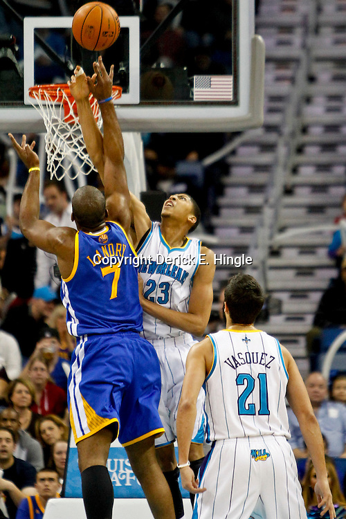 Jan 19, 2013; New Orleans, LA, USA; New Orleans Hornets power forward Anthony Davis (23) blocks a shot by Golden State Warriors power forward Carl Landry (7) during  the first quarter of a game at the New Orleans Arena. Mandatory Credit: Derick E. Hingle-USA TODAY Sports