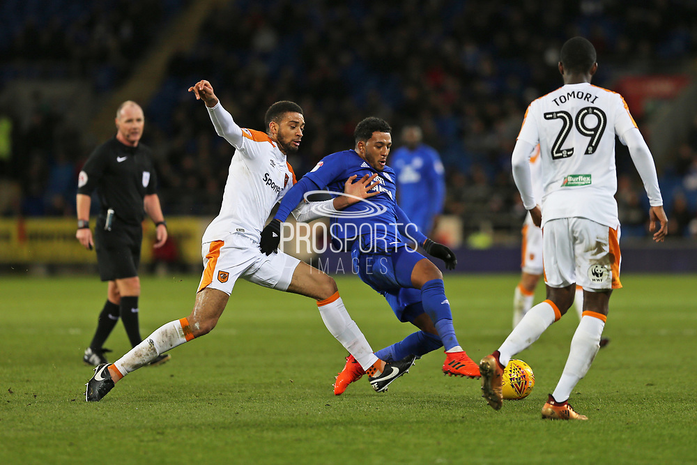 Cardiff City  Nathaniel Mendez-Laing (19) battles for the ball against  Hull City Michael Hector (5)  during the EFL Sky Bet Championship match between Cardiff City and Hull City at the Cardiff City Stadium, Cardiff, Wales on 16 December 2017. Photo by Gary Learmonth.