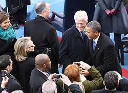 U.S. President Barack Obama talks with Hillary Clinton upon his arrival at the swearing-in ceremony for his second term as US president on the west front of the Capitol Hill in Washington D.C., capital of the United States, January 21, 2013. Photo by Imago / i-Images...UK ONLY