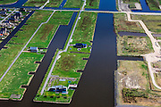 Nederland, Groningen, Oldambt, 01-05-2013; Blauwestad, nieuw aangelegd woongebied inclusief recreatiegebied. Het Oldambtmeer dient ook als waterberging. Wijk 'De Wei' met kavels voor zelfbouw, nog maar gedeeltelijk bebouwd.<br /> Het project Blauwe Stad was oorspronkelijk bedoeld om de economisch achtergebleven regio van Noordoost Groningen een impuls te geven. De economische en huizen crisis gooit echter roet in het eten.<br /> Blauwestad (Blue City) newly constructed residential area, including recreational lake. The Oldambt lake also serves as water storage. Area 'De Wei' (Meadow) with plots suited for 'DIY' buidling of houses. The Blue City project is meant to give a boost to the  economically backward region of northeast Groningen.<br /> luchtfoto (toeslag); aerial photo (additional fee required);<br /> foto Siebe Swart / photo Siebe Swart