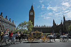 © Licensed to London News Pictures. 27/05/2015. London, UK. Queen Elizabeth II travels in a horse drawn carriage from Buckingham Palace infant of Elizabeth Clock Tower and the houses of parliament to attend State Opening of Parliament in London on May 27, 2015. Photo credit: Ben Cawthra/LNP
