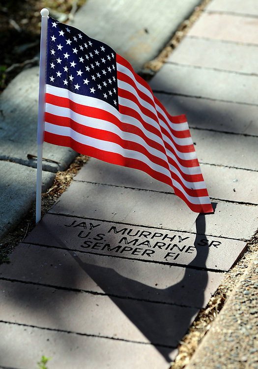 jt052917c/ a sec/jim thompson/A small American flag is placed next to a memorial brick for Jay Murphy Sr. at the Memorial Day Ceremony held at the New Mexico Veteran's Memorial. Monday May. 29, 2017. (Jim Thompson/Albuquerque Journal)