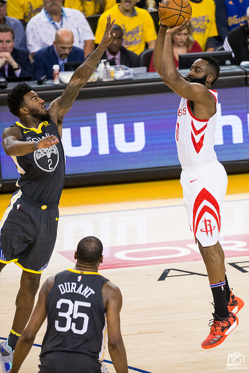 Golden State Warriors center Jordan Bell (2) attempts to block a shot by Houston Rockets guard James Harden (13) during Game 4 of the Western Conference Finals at Oracle Arena in Oakland, Calif., on May 22, 2018. (Stan Olszewski/Special to S.F. Examiner)