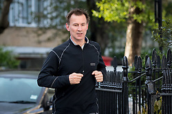© Licensed to London News Pictures. 03/05/2018. London, UK. Health and Social Care Secretary Jeremy Hunt returns home from a jog this morning. Hunt yesterday said that 450,000 patients in England missed crucial breast cancer screenings due to computer error in 2009, causing as many as 270 women to have had their lives cut short. The government has ordered an independent inquiry into the scandal. Photo credit : Tom Nicholson/LNP