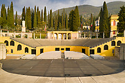 Amphitheatre, or Parlaggio, built 1931-52 and used for concerts, seating 1500, at the home of Gabriele D'Annunzio, 1863-1938, Italian writer, soldier and fascist, at Vittoriale degli italiani, or The Shrine of Italian Victories, his estate and museums at Gardone Riviera, Lake Garda, Brescia, Lombardy, Italy. The estate consists of the Prioria, where d'Annunzio lived 1922-38, an amphitheatre, the protected cruiser Puglia, the MAS vessel used by D'Annunzio in 1918 and a mausoleum. It is part of the Grandi Giardini Italiani. Picture by Manuel Cohen