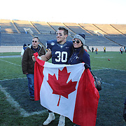 Yale running back Tyler Varga, with the Canadian flag after the Yale Vs Princeton, Ivy League College Football match at Yale Bowl, New Haven, Connecticut, USA. 15th November 2014. Photo Tim Clayton
