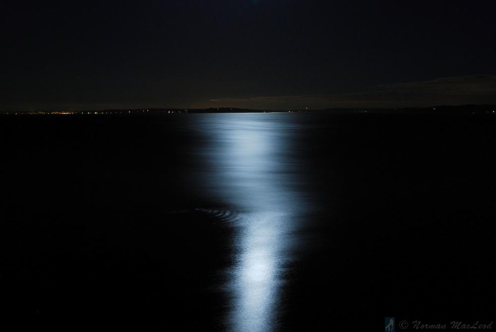 Moonlight on the water looking southeast from Marrowstone Island toward Edmonds