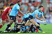 """Luke Burgess passes from the base of the ruck for the Waratahs during action from the Super 15 Rugby Union match played between the Queensland Reds and the NSW Waratahs at Suncorp Stadium (Brisbane, Australia) on Saturday 23rd April 2011<br /> <br /> Conditions of Use : NO AGENTS ~ This image is intended for Editorial use only (news or commentary, print or electronic) - Required Images Credit """"Steven Hight - Aura Images"""""""