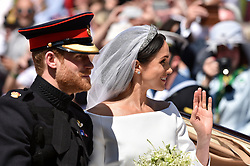 Prince Harry, Duke of Sussex and Meghan, Duchess of Sussex leave Windsor Castle in the Ascot Landau carriage during a procession after getting married at St Georges Chapel on May 19, 2018 in Windsor, England. Prince Henry Charles Albert David of Wales marries Ms. Meghan Markle in a service at St George's Chapel inside the grounds of Windsor Castle. Among the guests were 2200 members of the public, the royal family and Ms. Markle's Mother Doria Ragland. Photo by Lionel Hahn/ABACAPRESS.COM
