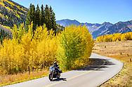 Motorcycle riders on Castle Creek Road in Aspen, Colorado.