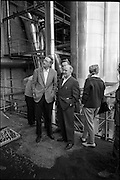 15/06/1963.06/15/1963.15 June 1963.Finnish visitors tour Bord na Mona works..the 48 members of the Finnish Peat Society, who arrived in dublin on Friday 14/06/1963, toured Bord na Mona works in Offaly and Kildare on Saturday..Mr. V. Puustjarvi, University of Helsinki (right) and Mr. P. McEvilly, Manager Croghan Briquette Factory, pausing to view the exterior during a tour of Croghan briquette factory near Mount Lucas, Co. Offaly. .