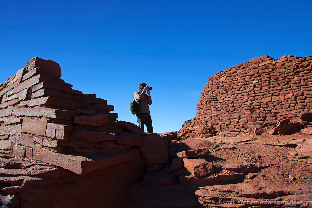 North America, USA, Arizona, Wupatki. Photographer at Wukoki Pueblo in Wupatki National Monument.