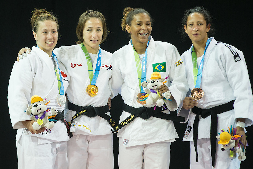 Gold medalist Marti Malloy (2nd Left) of the United States is joined by silver medalist Catherine Beauchemin-Pinard (L) of Canada, and bronze medalists Aliuska Ojeda (R) of Cuba and Rafaela Silva of Brazil during the medal ceremony for the women's judo 57kg class at the 2015 Pan American Games in Toronto, Canada, July 12,  2015   AFP PHOTO/GEOFF ROBINS