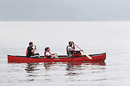 New Windsor, New York - Three young adults enjoy a canoe ride on the Hudson River at the Paddlefest event sponsored by the Mid-Hudson Chapter of the Adirondack Mountain Club at Kowawese Unique Area at Plum Point on  Sunday, June 13, 2010.