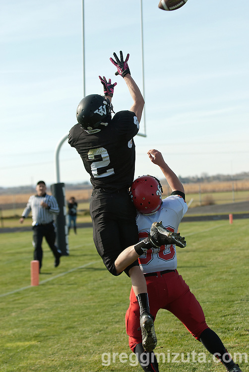 Agi Tamez goes high over Micah McLeod for the catch during the first quarter of the Vale Clatskanie round 1 playoff game, November 9, 2013 at Frank Hawley Stadium Vale High School, Vale, Oregon. The pass fell incomplete but Vale won the game 46-0 to advance to the quarterfinals.