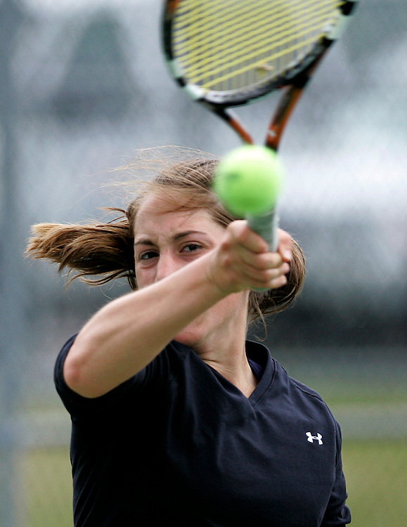 tennis wn 052408-6.JPG.BOSTON May 24: Athletes from around New England compete at the New England Prep School Girls Tennis Championship at Milton Academy on Saturday. Tori Aiello of Milton Academy returns serve in her second round consolation match against Carolyn Jay of Westover Academy. ..Photos by Will Nunnally for the Patriot Ledger