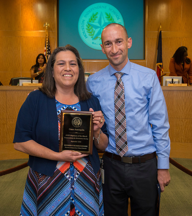 Daniel Greenberg, right, presents Grace Amezquita with the September Employee of the Month recognition during a meeting of Houston ISD Board of Trustees, September 8, 2016.
