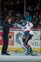 KELOWNA, CANADA - JANUARY 10: Athletic therapist, Scott Hoyer assesses Roman Basran #30 of the Kelowna Rockets on the ice against the Spokane Chiefs on January 10, 2017 at Prospera Place in Kelowna, British Columbia, Canada.  (Photo by Marissa Baecker/Shoot the Breeze)  *** Local Caption ***