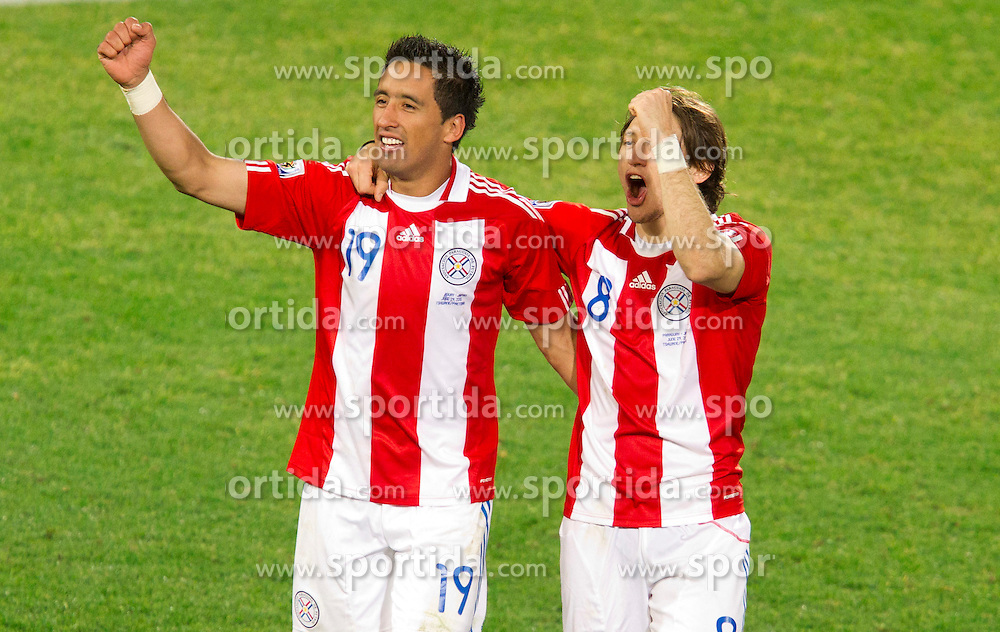 Lucas Barrios and Edgar Barreto of Paraguay celebrate after the penalty shots after 0-0 in overtime during the 2010 FIFA World Cup South Africa Round of Sixteen football match between Paraguay and Japan on June 29, 2010 at Loftus Versfeld Stadium in Tshwane/Pretoria. (Photo by Vid Ponikvar / Sportida)