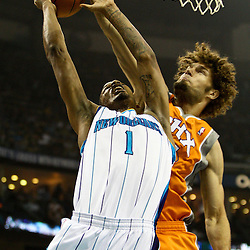 April 8, 2011; New Orleans, LA, USA; New Orleans Hornets small forward Trevor Ariza (1) has a shot blocked by Phoenix Suns center Robin Lopez (15) during the first quarter at the New Orleans Arena.  Mandatory Credit: Derick E. Hingle