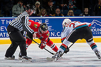 KELOWNA, CANADA - JANUARY 21: Linesman Cody Wanner drops the puck between Alex Overhardt #17 of the Portland Winterhawks and Calvin Thurkauf #27 of the Kelowna Rockets on January 21, 2017 at Prospera Place in Kelowna, British Columbia, Canada.  (Photo by Marissa Baecker/Shoot the Breeze)  *** Local Caption ***