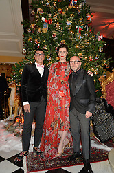 Left to right, STEFANO GABBANA, ERIN O'CONNOR and DOMENICO DOLCE at a party to celebrate the unveiling of the 2014 Claridge's Christmas tree by Dolce & Gabbana at Claridge's, Brook Street, London on 19th November 2014.