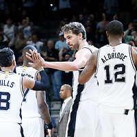 04 April 2017: San Antonio Spurs guard Patty Mills (8) is congratulated by San Antonio Spurs center Pau Gasol (16) during the San Antonio Spurs 95-89 OT victory over the Memphis Grizzlies, at the AT&T Center, San Antonio, Texas, USA.