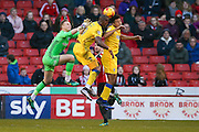 AFC Wimbledon forward Tom Elliott (9) wins the header ahead of Sheffield United goalkeeper Simon Moore (25)  during the EFL Sky Bet League 1 match between Sheffield Utd and AFC Wimbledon at Bramall Lane, Sheffield, England on 4 February 2017. Photo by Simon Davies.