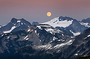 Full moon rising over Mount Challenger, North Cascades National Park Washington