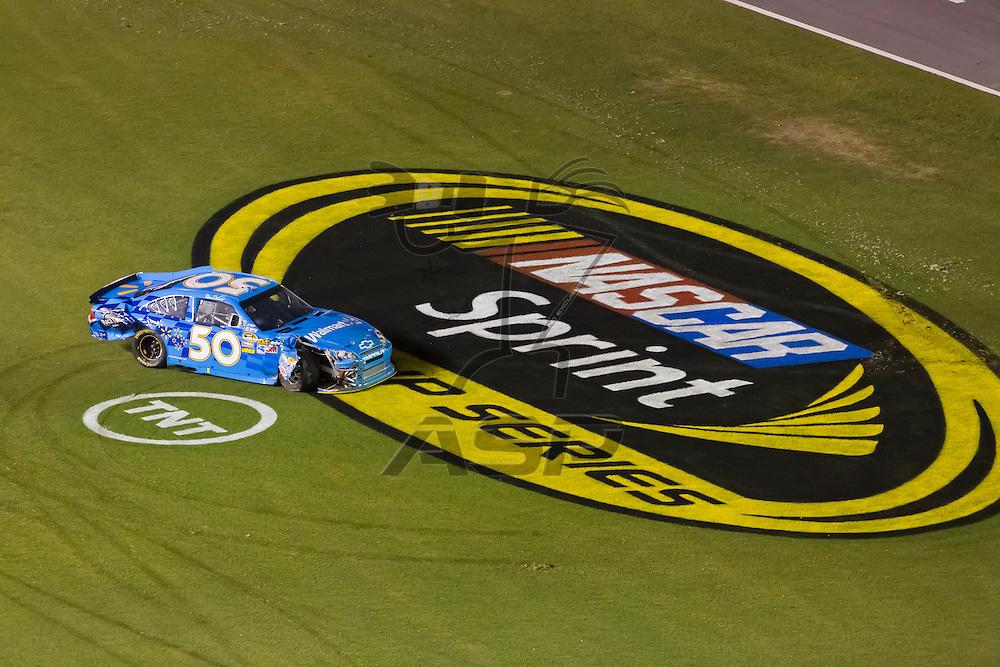 DAYTONA BEACH, FL - JUL 07, 2012:  The Walmart Chevrolet sits in the front stretch after wrecking during the Coke Zero 400 at the Daytona International Speedway in Daytona Beach, FL.