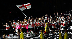 England's flag bearer Alistair Brownlee leads the team out during the Opening Ceremony for the 2018 Commonwealth Games at the Carrara Stadium in the Gold Coast, Australia. PRESS ASSOCIATION Photo. Picture date: Wednesday April 4, 2018. See PA story COMMONWEALTH Ceremony. Photo credit should read: Martin Rickett/PA Wire. RESTRICTIONS: Editorial use only. No commercial use. No video emulation