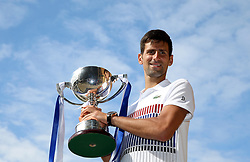 Serbia's Novak Djokovic poses with the trophy after winning against France's Gael Monfils in the Men's Singles Final during day nine of the AEGON International at Devonshire Park, Eastbourne.