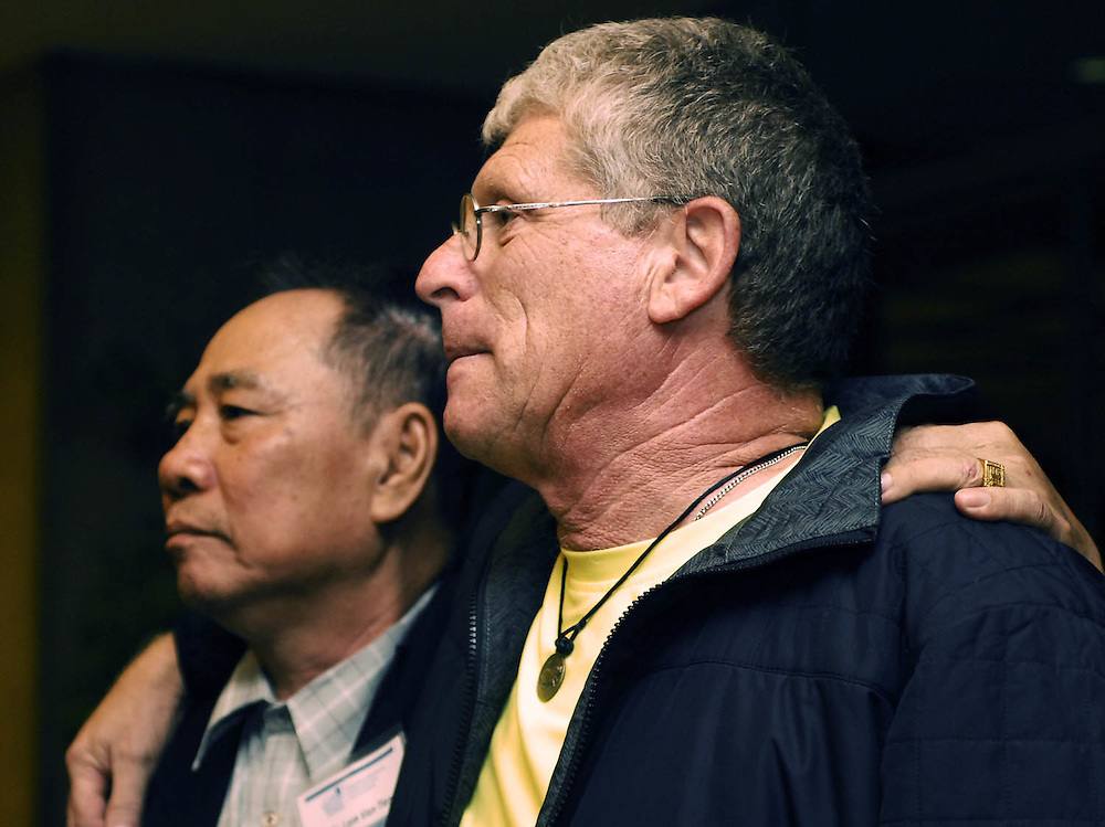 Former Viet Cong soldier Tam Tien, of the Mekong Delta, Vietnam, and Former American GI Joe Caley, of Tallmadge Ohio, stand arm-in-arm at the Cleveland Museum of Art.  Tien was one of four Vietnamese delegates selected to speak at Case Western University's International Summit on Peace and War in October, 2010.  Tien and his family hosted the Tallmadge group Warriors Journey Home when they visited the Mekong Delta earlier that month. Cleveland, Ohio,  Oct. 27, 2010. (Laura Fong Torchia/Special to the Akron Beacon Journal)