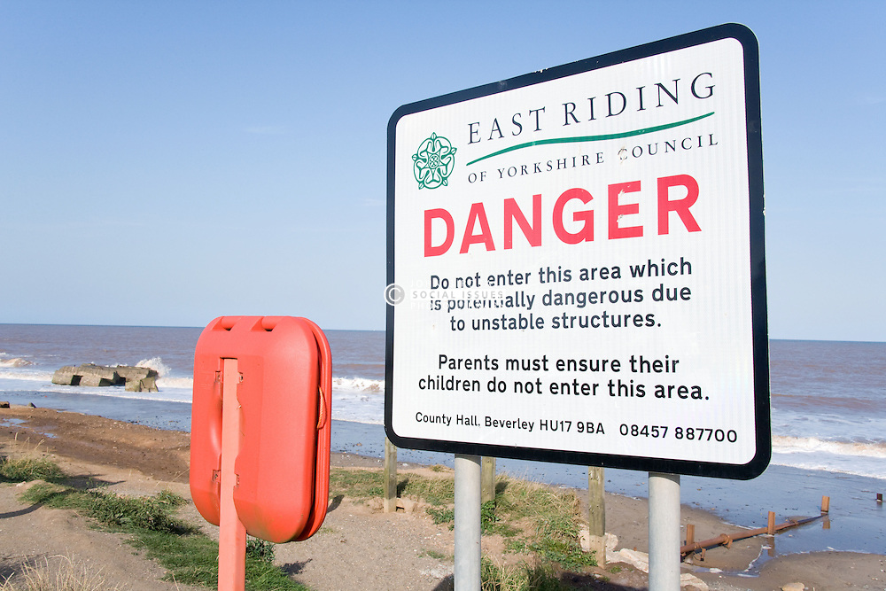 Sign warning of danger near to the remains of the Godwin Coast Artillery Battery; wartime defence at Kilnsea; East Yorkshire; England,