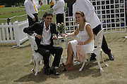 Mr. and Mrs. Oliver Marre, Veuve Clicquot Gold Cup 2006. Final day. 23 July 2006. ONE TIME USE ONLY - DO NOT ARCHIVE  © Copyright Photograph by Dafydd Jones 66 Stockwell Park Rd. London SW9 0DA Tel 020 7733 0108 www.dafjones.com