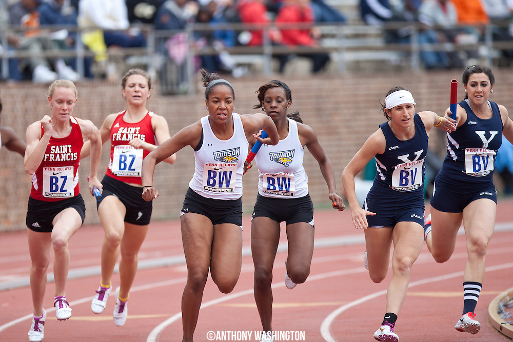 Maya Hinton of Towson University grabs the baton from teammate Kiera Joyner during the College Women's 4x100 (Heats)at the Penn Relays athletic meets on Thursday, April 26, 2012 in Philadelphia, PA.