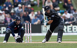 New Zealand's Ross Taylor, right, plays a shot as England's Jos Buttler keeps wicket in the fourth one day cricket international at the University of Otago Oval, Dunedin, New Zealand, Wednesday, March 7, 2018. Credit:SNPA / Adam Binns ** NO ARCHIVING**