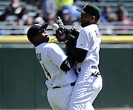 CHICAGO - APRIL 03:  Alexei Ramirez #10 (R) collides with Dayan Viciedo #24 of the Chicago White Sox while attempting to catch a pop fly hit by Chris Getz in the third inning against the Kansas City Royals on April 3, 2013 at U.S. Cellular Field in Chicago, Illinois.  The White Sox defeated the Royals 5-2.  Ramirez was charged with an error on the play.(Photo by Ron Vesely)   Subject: Alexei Ramirez; Dayan Viciedo; Chris Getz