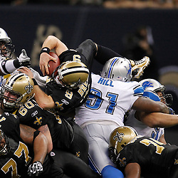 January 7, 2012; New Orleans, LA, USA; New Orleans Saints quarterback Drew Brees (9) dives over the line for a first down against the Detroit Lions during the 2011 NFC wild card playoff game at the Mercedes-Benz Superdome. Mandatory Credit: Derick E. Hingle-US PRESSWIRE