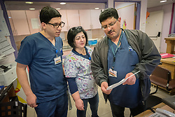 24 February 2020, Jerusalem: Head nurse of the specialized paediatrics care unit Mohammad Kabaja (right) talks to his colleagues Rihab George (centre) and Aiman Ali (left).