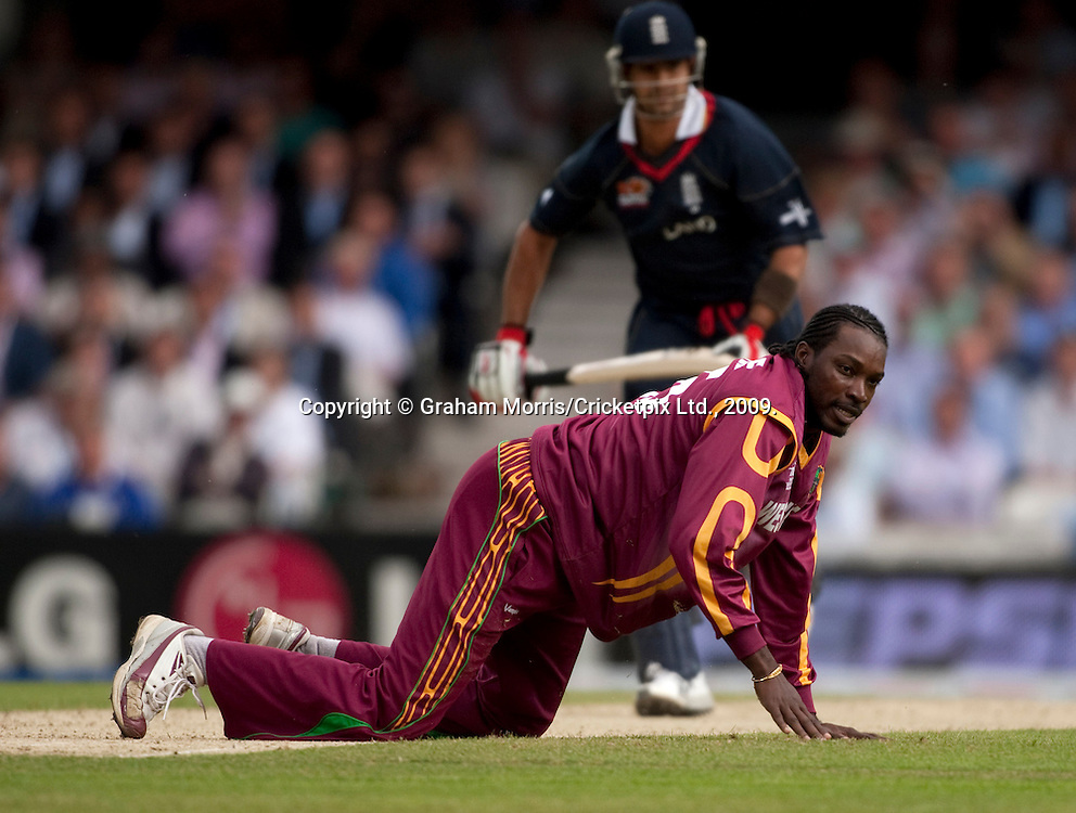 Owais Shah runs past downed bowler Chris Gayle during the ICC World Twenty20 Cup match between West Indies and England at The Oval. Photo © Graham Morris (Tel: +44(0)20 8969 4192 Email: sales@cricketpix.com)