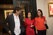 EDUARDO NOVILLO ASTRADA;  ZAHRA KASSIM-LAKHA; MICHELLE LAVERY;, preview of 'UNBRIDLED SYNCHRONY', an exhibition of works by photographer Astrid Muñoz. Jaeger-LeCoultre Boutique<br /> 13 Old Bond Street. London. 13 July 2015